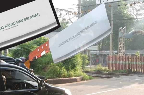 11. Социальная реклама на железнодорожном переезде в Индонезии